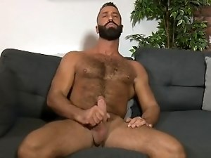 Greek stud Lex Anders tweaks his nipples while jacking his cock