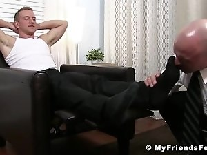 Bald hunk loves being dominated over by licking jocks feet hard